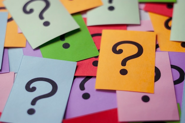Colorful cards with printed question marks Premium Photo