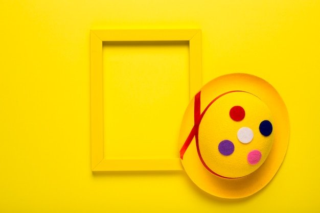 Colorful carnival mask with yellow frame Free Photo
