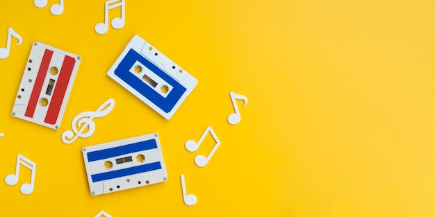Colorful cassette tapes on bright background with copy-space Free Photo