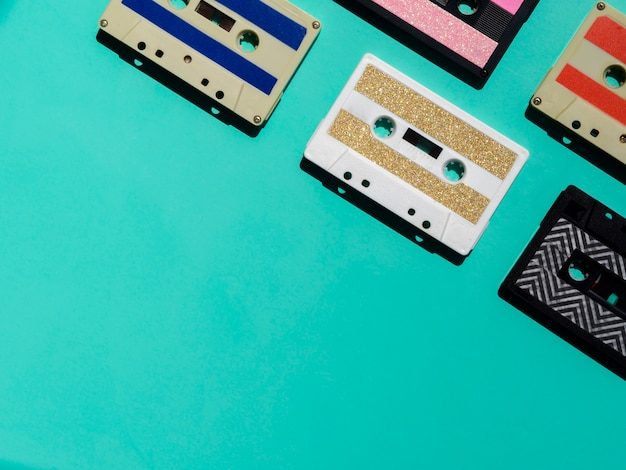 Colorful cassette tapes in corner with copy-space Free Photo