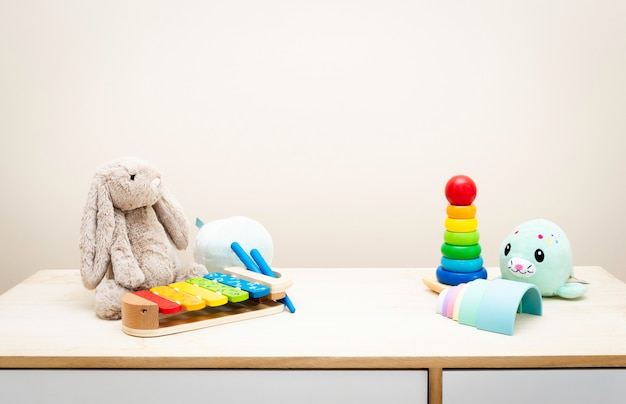 Of colorful children's toys against the wall toys on wood table with copyspace Premium Photo