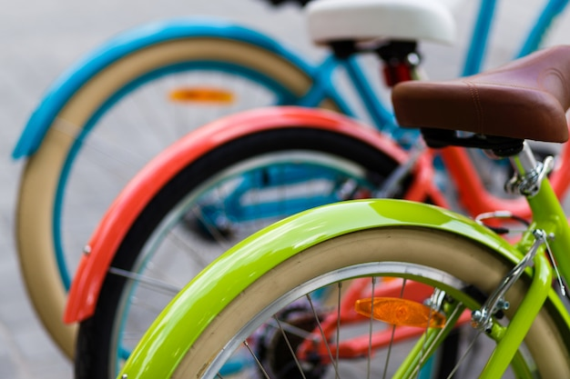 Colorful city bike row in the store Premium Photo