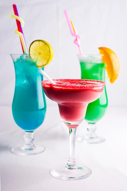 Colorful cocktails in glass on white background Premium Photo