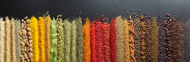 Colorful collection spices and herbs on background black table. Premium Photo