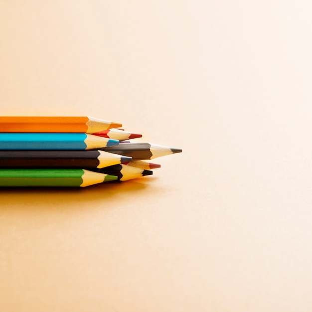 Colorful colored pencil on beige background Free Photo
