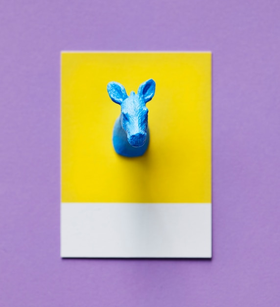 Colorful cow figure on a paper Free Photo