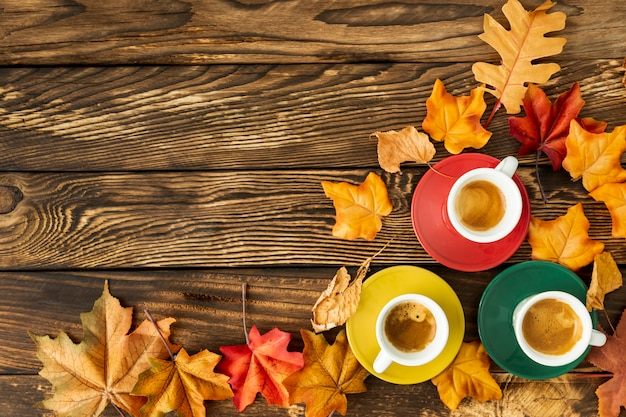 Colorful cups of coffee with copy space Free Photo