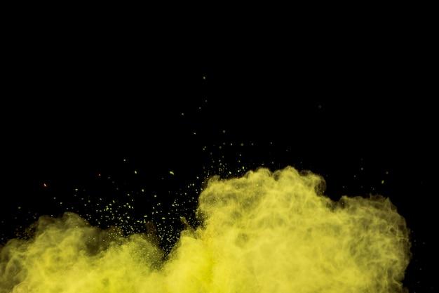 Colorful curling yellow powder cloud Premium Photo