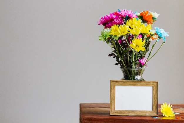 Colorful daisies in a vase Free Photo