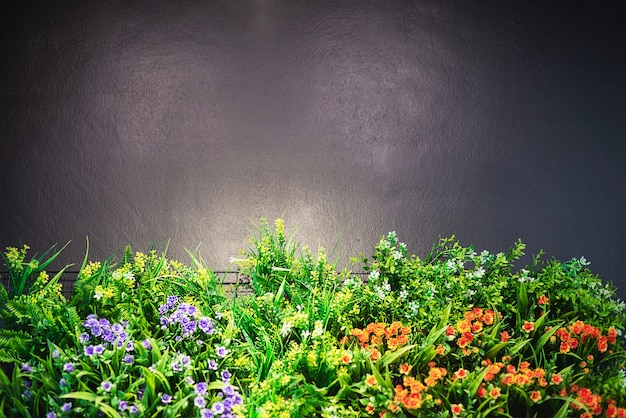 Colorful decorated flower garden with grey copy space on top and warm shiny spot light - flower garden picture Free Photo