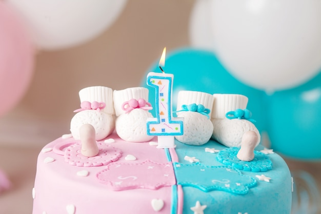 Colorful decoration of a first year birthday cake for twins Premium Photo