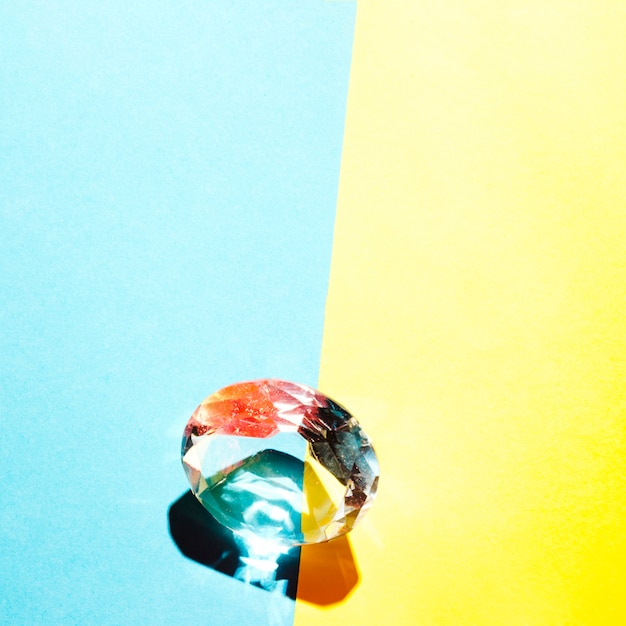 Colorful diamond on the border of dual blue and yellow background Free Photo