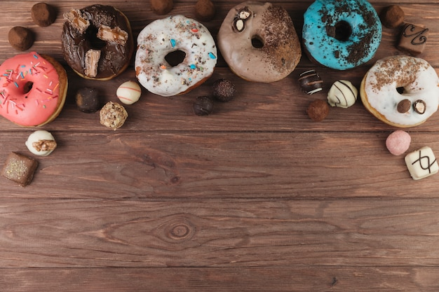 Colorful donuts with chocolate Free Photo