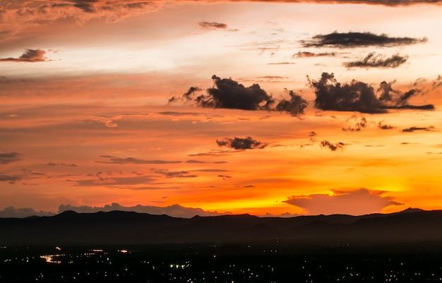 Colorful dramatic sky with cloud at sunset. Premium Photo