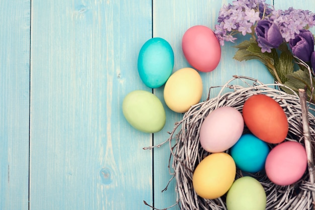 Colorful easter decarations on wooden plank Free Photo