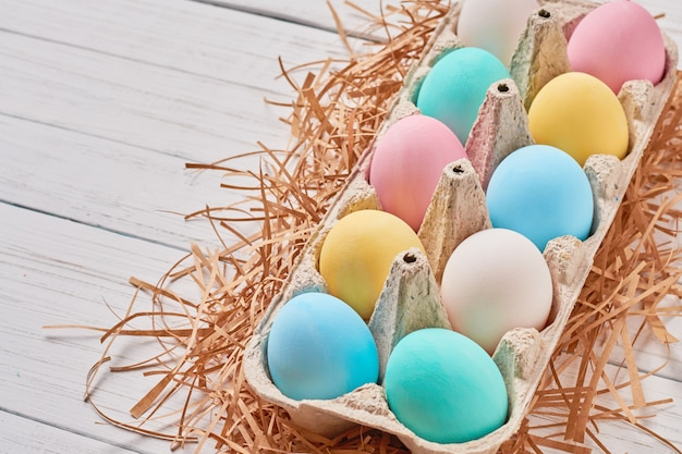 Colorful easter eggs in a paper tray close up Premium Photo