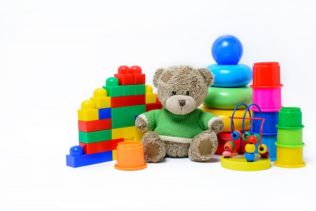 Colorful educational toys for children on a white surface Premium Photo