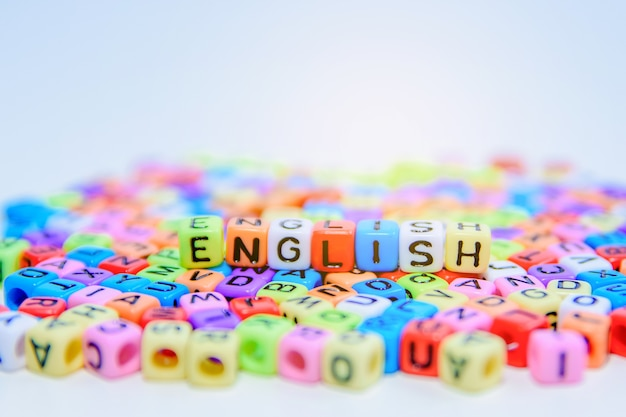 Colorful english alphabet cube on the floor. Premium Photo