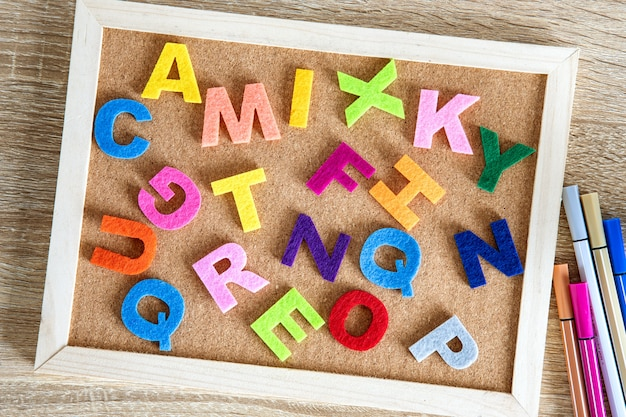 Colorful english  alphabet on a pin board background Premium Photo