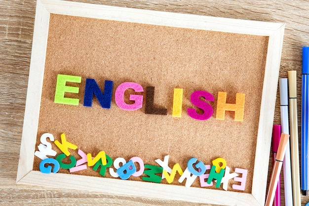 Colorful english word alphabet on a pin board background Premium Photo