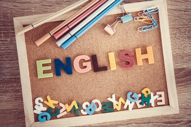 Colorful english word alphabet on a pin board, english language learning concept Premium Photo