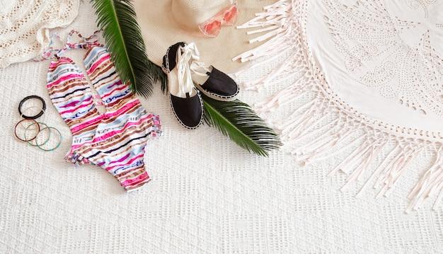 Colorful fashion women's summer swimsuit flat lay. Free Photo