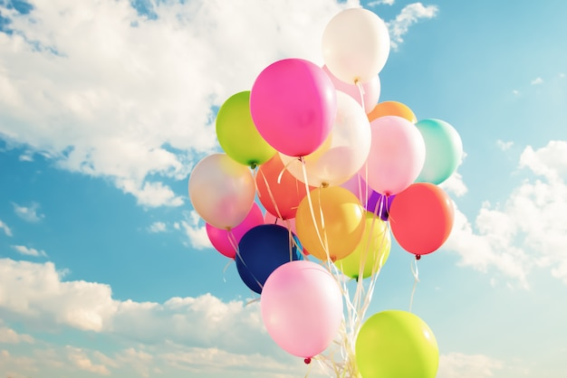 Colorful festive balloons over blue sky Premium Photo