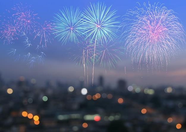 Colorful fireworks on blur city skyline background at twilight Premium Photo