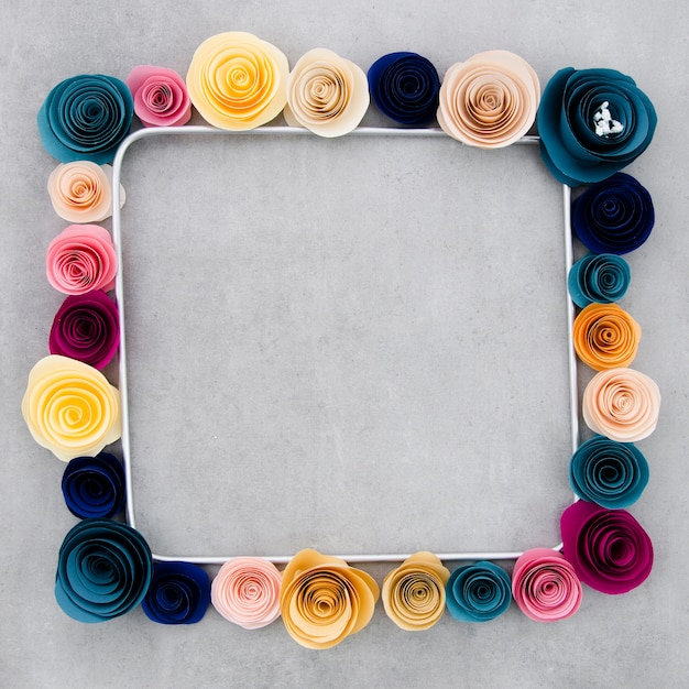 Colorful floral frame on cement background Free Photo