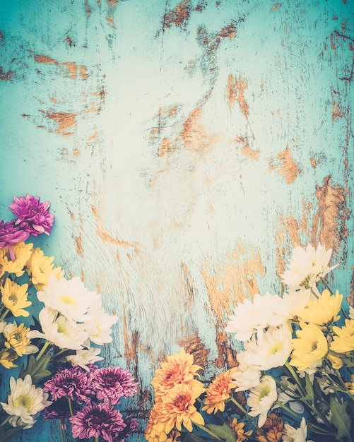 Colorful flowers bouquet on vintage wooden background, border design ...