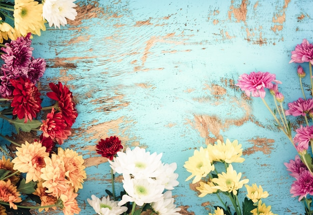 Colorful flowers bouquet on vintage wooden background ...
