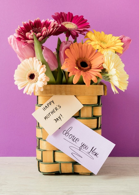 Colorful flowers with card Free Photo