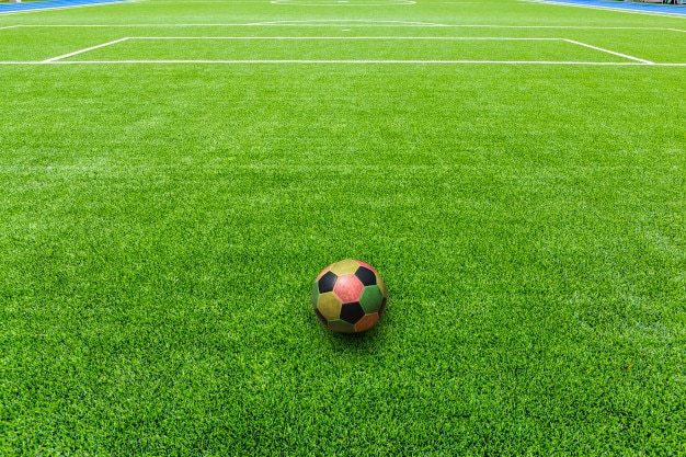 Colorful of football on football field or soccer field Premium Photo