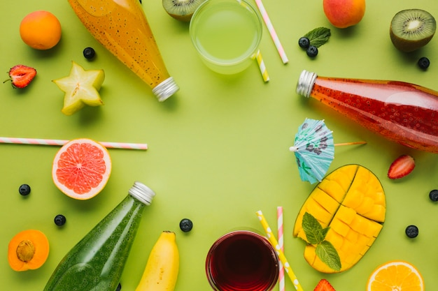 Colorful fruit and juices arrangement Free Photo