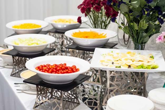 Colorful fruit  and small cakes arranged in the buffet corner ready to eat Premium Photo
