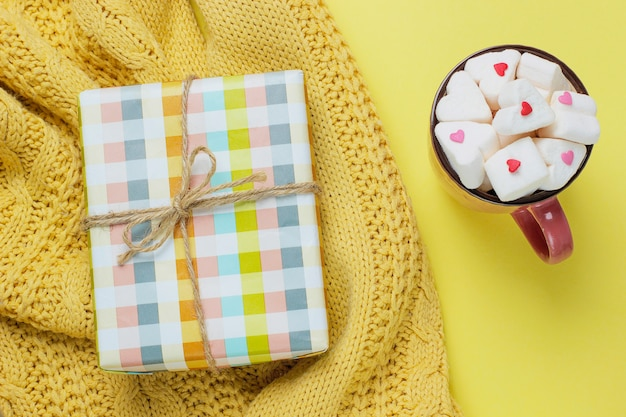 Colorful gift box isolated on yellow Free Photo