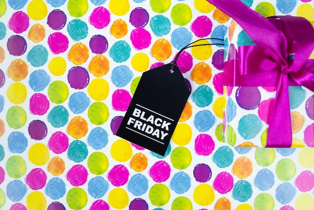 Colorful gift with tag on colorful background Free Photo