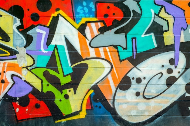 Colorful graffiti texture on wall as background Premium Photo