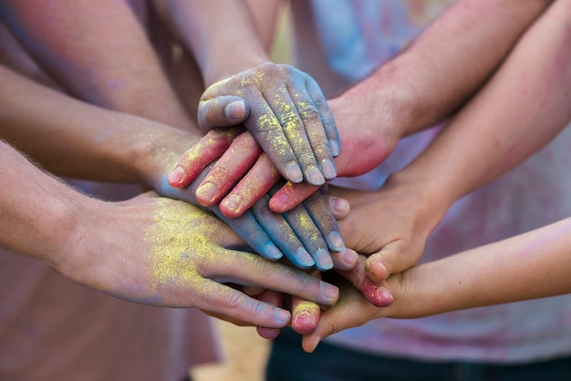 Colorful hands at festival close-up Free Photo