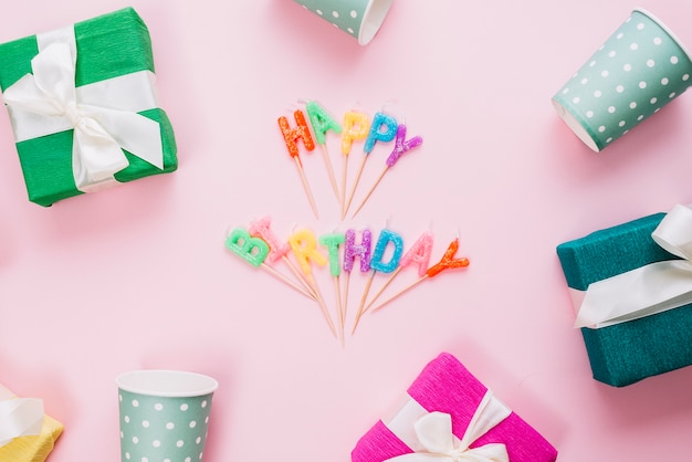 Colorful Happy Birthday Candles Surrounded With Gift Boxes And