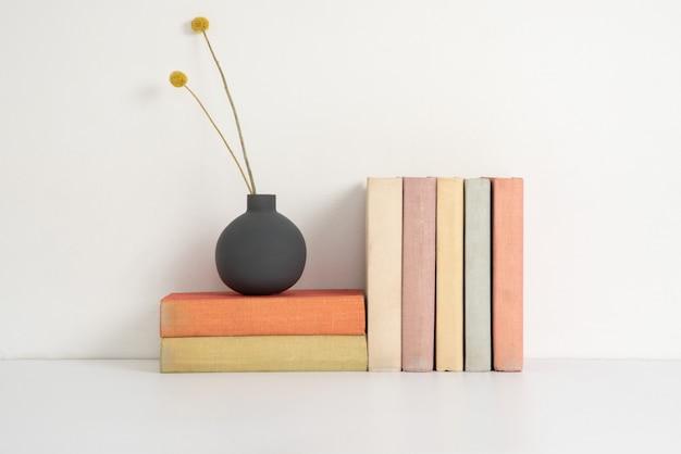 Colorful hardback books on the shelf Premium Photo