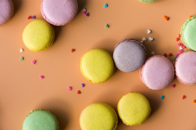 Colorful heart shape sprinkles with macaroons Free Photo