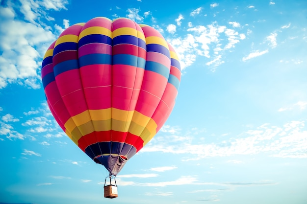 Colorful hot air balloon flying on sky. Photo | Premium ...