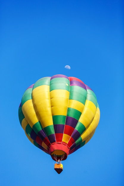 Colorful hot air balloon with moon in blue sky Premium Photo