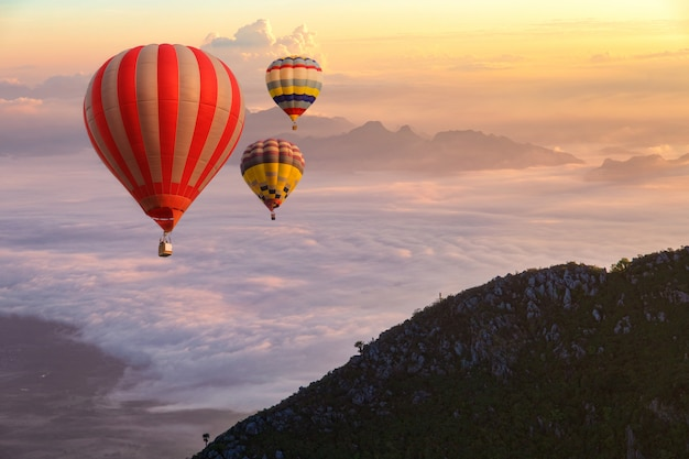 Colorful hot-air balloons flying over the doi luang chiang dao Premium Photo