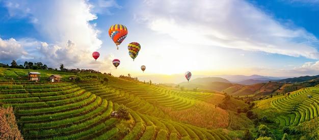 Colorful hot air balloons. sunset scene of ban bun loe school, mae hong son thailand Premium Photo