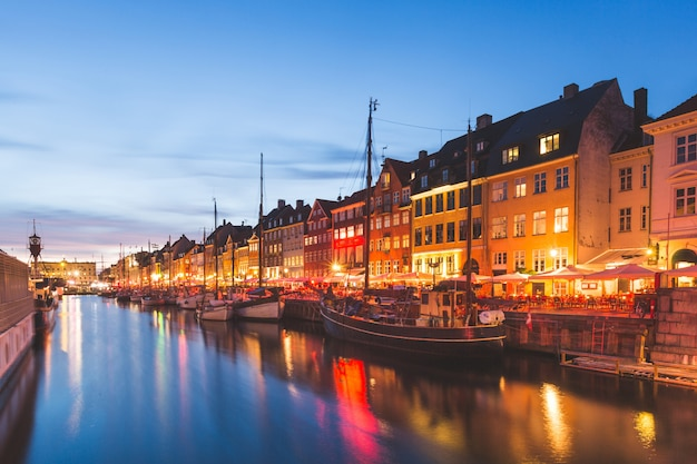 Colorful houses in copenhagen old town at night Premium Photo