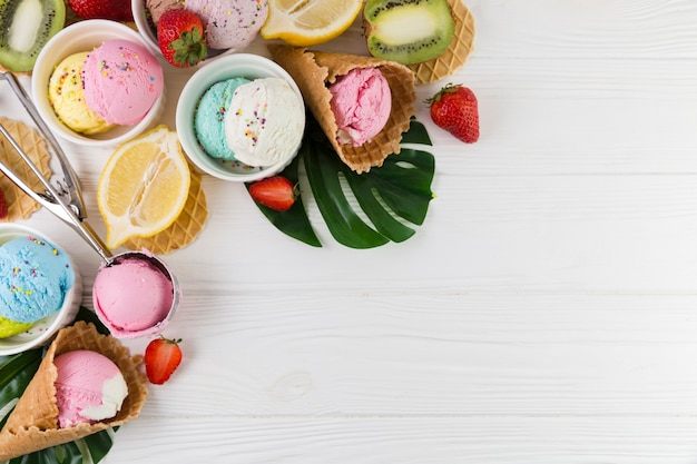 Colorful ice cream served with fruits Free Photo