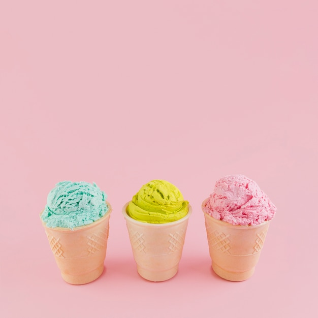 Colorful ice cream in waffle cups Free Photo