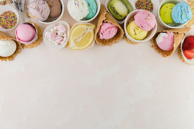 Colorful ice cream with sweets and fruits Free Photo